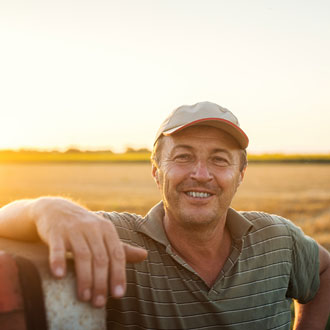 Farmer with a stewardship agreement in field