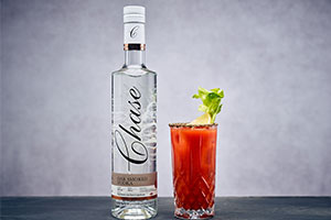 Chase vodka brand with glass of red cocktail