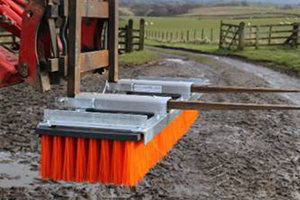 Forklift sweeper attachment on mud