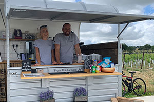 Horsebox bar from Kinsbrook Vineyard with staff serving from the hatch